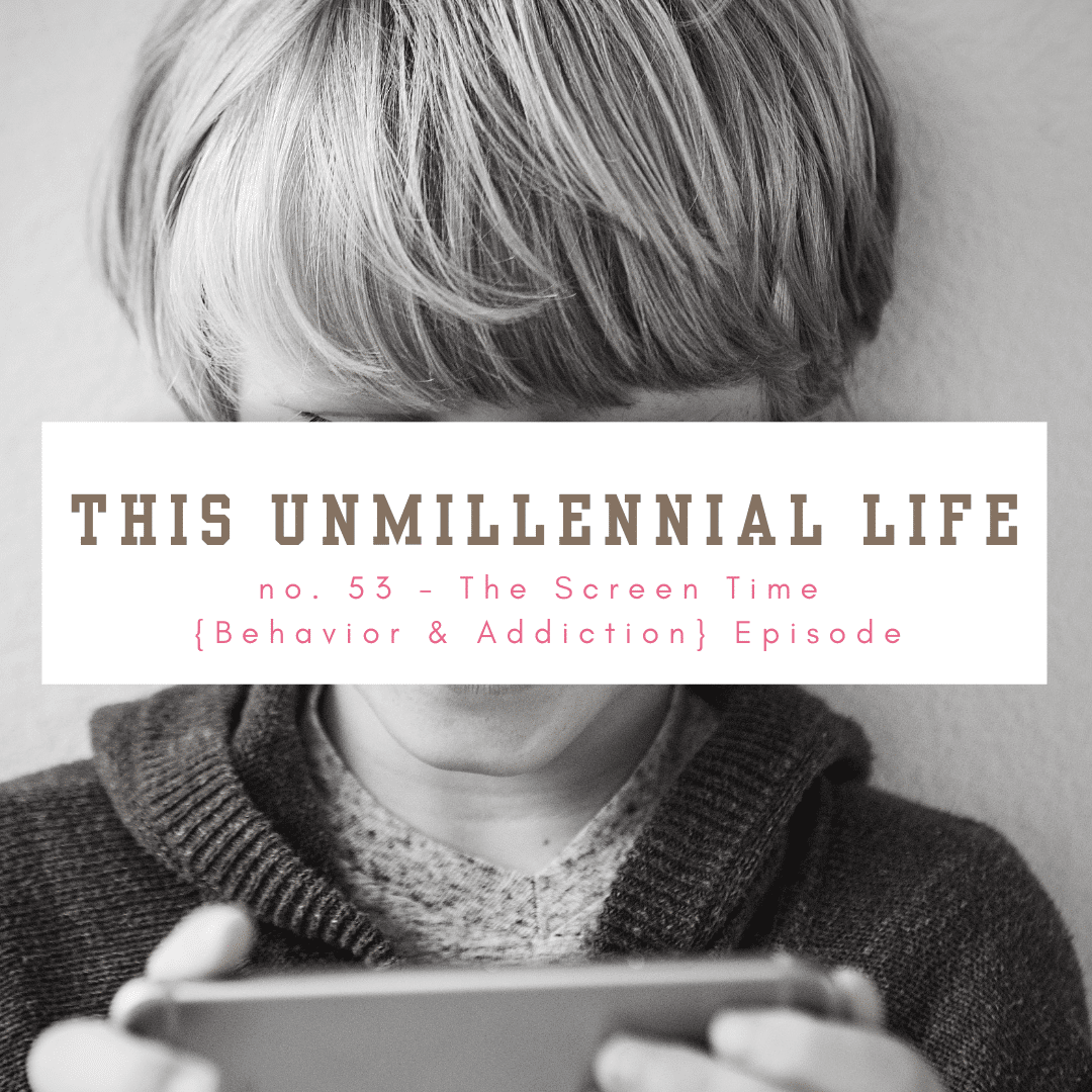 child holding iphone addicted to screen time
